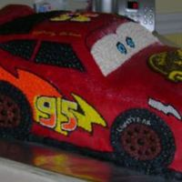 Lightning Mcqueen  This cake had some issues. After it was carved and frosted the back end fell off. It was reattached and supported with styrofoam (the part...