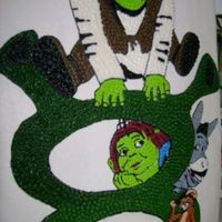 Shrekcake.jpg   Shrek the Third...made to be Shrek 8 for a friend's daughter. BC drawn and filled free hand.