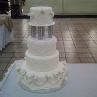 My Version Of The Masterpiece Wedding Cake From Wilton I made this cake for bridal show at the mall. It's a cake dummy with fondant and fondant flowers. The piping took me a week and I...