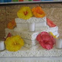 Hawaiian Theme Carrot Cake BC frosting on Carrot Cake. Hibiscus flowers made of gumpaste