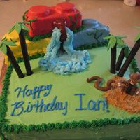 124292740132414.jpg Indiana Jones Lego cake made with fondant and BC. The legos made of rice krispy bars and oreos covered in fondant, trees are made of...