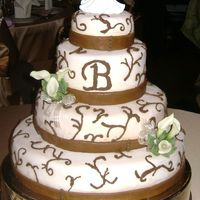 My 1St Wedding Cake Italian cream with cream cheese icing cover in ivory fondant with brown piping and brown fondant ribbon.