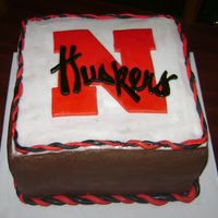Nebraska Huskers The groom was specific on that he wanted choc. cake with choc. icing. I thought the white fondant let the N stand out more. He was very...