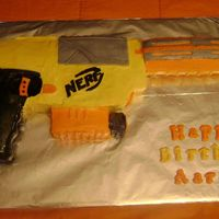 Nerf Gun My creation of a 9 yr olds favorite nerf gun! Made with BC icing and fondant accents. He thought it looked just like his gun!