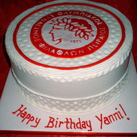 Olympiacos Birthday Done for a fan of the Olympiacos soccer team, 10 inch buttercream with fondant circle and stenciled logo.