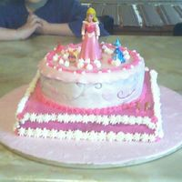 Sleeping Beauty Princess Birthday Cake  This is a cake created for our oldest daughters birthday. She wanted a sleeping beauty cake. Hte figurine is purchased in the toy...