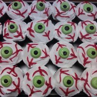 Eye-Ball Cupcakes Sugar cookie decorated with RI