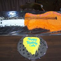 Briana's Guitar Cake This cake was made for my daughter's 7th Birthday she had a Hannah Montana Theme and a friend of her's birthday was the day we...