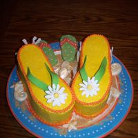 Flip Flops With Seashells Flip Flops are layered cakes so I could feed more people. Buttercream with royal flowers and white chocolate seashells. The coral is made...