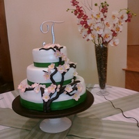 Cherry Blossom Green Ribbon Wedding Cake First Wedding Cake I have made. Fondant cake - Cherry Blossoms with green ribbon.