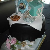 """breakfast At Tiffanys"" Cake for a 21 year old girl's birthday by the name of Kellie.The silver bottom (floor area) is cake,the table top is cake...and..."