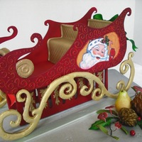 """the Red Sleigh"" The sleigh,fruits,pinecones,etc. were completely out of gumpaste for a jewelry store window display.The painting of SANTA was done with..."
