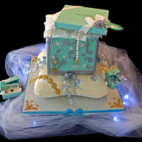 Tiffany Cake Tiffany box cake on a pillow cake for a 21 year old girl's birthday.all other small Tiffany boxes and jewelry are made from gumpaste...