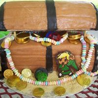 Link Treasure Chest My son loves link/legend of zelda from nintendo.He wanted a link cake, this was our compromise.Covered in rolled buttercream.Link was made...