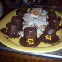 Pilgrim Hats chocolate covered marshmallows stuck to fudge stripe cookies - -- saw these on CC