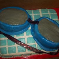 Goggle Cake made this cake to represent a pair of swim goggles.Goggles made with small oval pan (from Wilton course 2, I think)Covered in rolled...