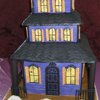 Spooky Mansion This is a 3 tier spooky mansion cake