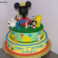 Mickey Mouse Clubhouse I got this idea from a picture of one I saw online, I dont remember where. I made the the topper out of RK and it was my first timeusing RK...