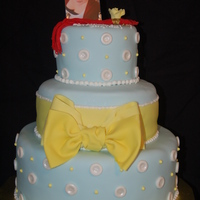 "High School Graduation Bow Cake 3 tie( 12"",8"", 6"") white chocolate cake with white chocolate ganache filling, middle layer butter cake with bavarian cream..."