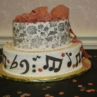 Musical Birthda;y Music notes, gold and black accents, gumpaste roses and bows with ribbon.