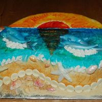 Beach, Shells, Dolphins, Sunset Beachy sunset scene with fondant shells, fondant dolphins and painted sunset with food colors. Crushed van. wafers for sand and toasted...