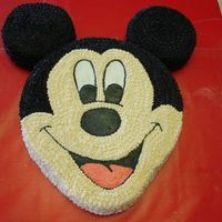 "Mickey Mouse Cake This is a cake I made for a friend's birthday party. Mickey Mouse head cake. 12""round with two 6"" rounds for the ears. I..."