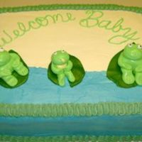 Frog Baby Shower Cake I was asked to make a frog cake for a baby shower. This is what I came up with. I made a mommy frog, a daddy frog and a baby frog. The...