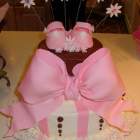 "Baby Gracie's Cake Here is a cake I made for my friend's baby shower. Pink fondant bow, baby booties, flowers and dots! Chocolate 6"" cake and..."