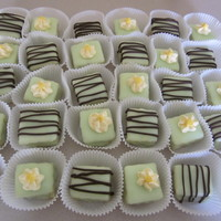Petit Fours Made for a baby shower to fit the light green/brown theme.