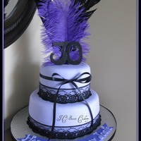 "Purple Passion 9"" & 6"", strawberry shortcake & chocolate w/buttercream. Covered in MMF w/lace & feathers. TFL"