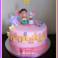"Dora   8"" vanilla w/cookies & cream filling. Gumpaste butterflys/explorer stars/#3. Plastic figures. Fun to make:) TFL"