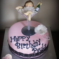 "Bubbles  9"" chocolate w/cookies & cream filling. Gumpaste flower & girl in edible pearls. Real lace around cake & champagne candle..."
