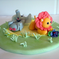 Frolicking Just a bit of experimenting.Fondant baby elephant & lion having a play.