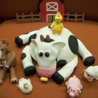 Farm Animals These little farm animals are going on a baby shower cake. The horse is holding a bottle. His shoes are on backwards. The cow has a...