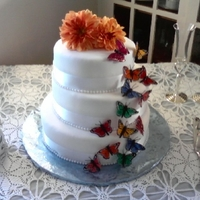 Butterfly Wedding Cake This was my first wedding cake. I made it for my best friend and we were so pleased with the outcome. Real flowers on top from the brides...