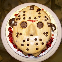 "Jason Voorhees' Mask From Friday The 13Th, Part 6 Was asked to do this for an avid horror film fan for his birthday. Fondant covered and the ""blood"" is thickened colored piping..."