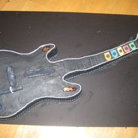 Guitar Hero covered in buttercream, with fodant accents. its the exact size as the xbox controller