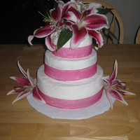 Simple Pink all buttercream, pink ribbon, and real stargazer lilies