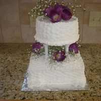 White Wedding With Purple Flowers this was just a basic basketweave. I added purple tulips and baby's breath to match brides bouquet. Very simple, I did it for a friend...