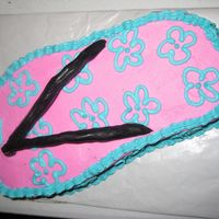 Flip Flop flip flop carved from chocolate cake, covered in buttercream with fondant straps