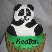 Kung Fu Panda 3d bear cake pan, on top of 10 in rounds, rolled wafers around cake to look like bamboo