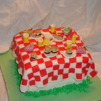 Summer Picnic this was so fun to make. Table cloth is fondant, food is gumpaste.