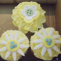 Whimsical Garden Baby Shower Cupcakes  These are lemonade cupcakes with vanilla buttercream frosting and fondant flowers. The flowers were made to match the nursery bedding which...