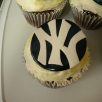 New York Yankees Cupcakes Chocolate cupcakes with cream cheese frosting and hand cut Yankees emblems for my sons tball team. I cut a disk of white fondant and...