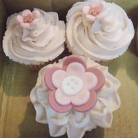 Whimsical Garden Cupcakes  These are strawberry lemonade cupcakes with a vanilla buttercream frosting. The fondant flowers were made to match the nursery bedding that...