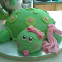 "Baby Girl Turtle Shower Cake This a turtle ""turtle"" cake, alternating layers of chocolate fudge cake, chocolate ganche, chopped pecans and caramel buttercream..."