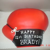 Boxing Glove Birthday Cake I made this cake for a friend who is a boxer. Choclate cake with fondant.