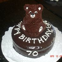 Grandpa's 70Th Teddy Bear Birthday Cake My dad turned 70 today. I made him this teddy bear cake. Marble cake with choc ganache, teddy bear pan topper decorated in buttercream. He...