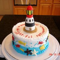 Lighthouse Retirement Cake This is for one of DH's coworkers, who likes lighthouses and is soon retiring. Fondant lighthouse. Candy letters, fish and starfish...