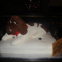 My Dog Jazz In His Bed Dog in a doggie bed . The dog was made of RKT and Fondant and the bed was the cake. The dog was an exact replica of the client's dog...